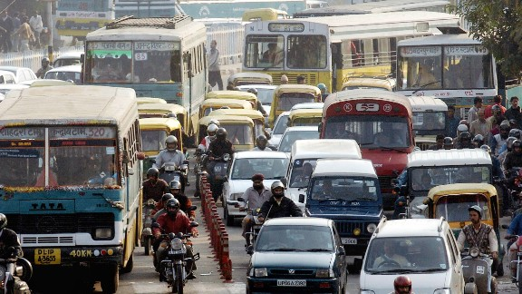 Cars, motorcycles, and buses form a massive traffic jam in a street in central New Delhi. Jams like these are daily occurrence, and can prevent emergency services access to accidents.
