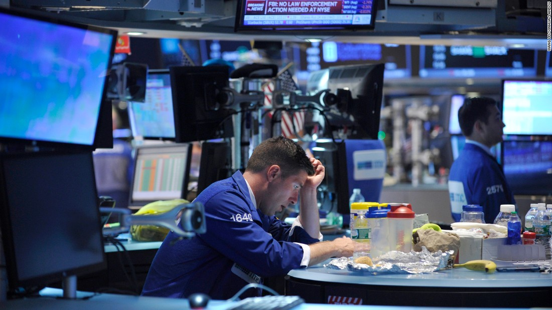 "A trader waits at the New York Stock Exchange while <a href=""http://money.cnn.com/2015/07/08/investing/nyse-suspends-trading/"" target=""_blank"">trading was halted for nearly four hours</a> on Wednesday, July 8. In a brief announcement, the exchange said it was experiencing an ""internal technical issue."" It later said in a tweet that the outage was ""not the result of a cyber breach."""