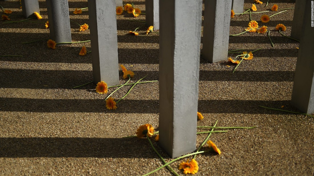 "Flowers are scattered at a memorial in London's Hyde Park on Tuesday, July 7. <a href=""http://www.cnn.com/2015/07/07/europe/uk-london-terror-attack-anniversary/"" target=""_blank"">Ten years have passed</a> since four coordinated bomb attacks tore apart subway trains and a bus in central London, killing 52 people and injuring hundreds more."
