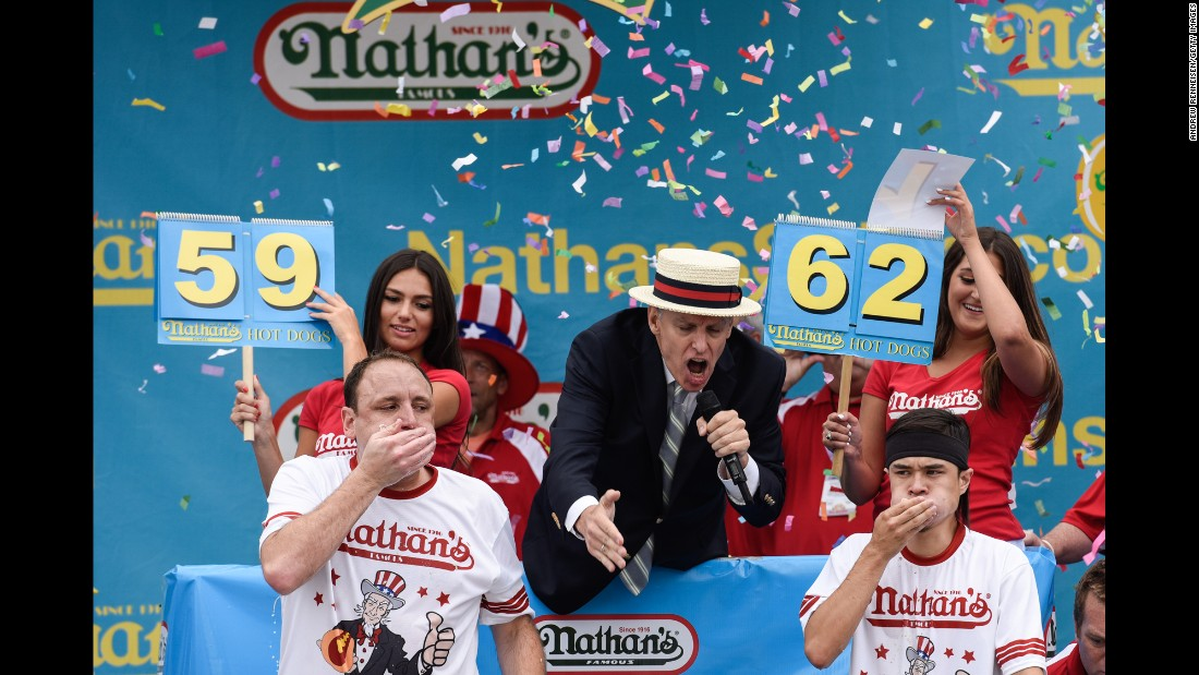 "Matthew ""Megatoad"" Stonie, right, devours his 62nd hot dog in 10 minutes <a href=""http://www.cnn.com/2015/07/04/us/new-york-hot-dog-contest/"" target=""_blank"">to win the Nathan's hot-dog eating contest </a>Saturday, July 4, in New York. It was the first time in nearly a decade that Joey Chestnut, left, had not finished first in the annual event."