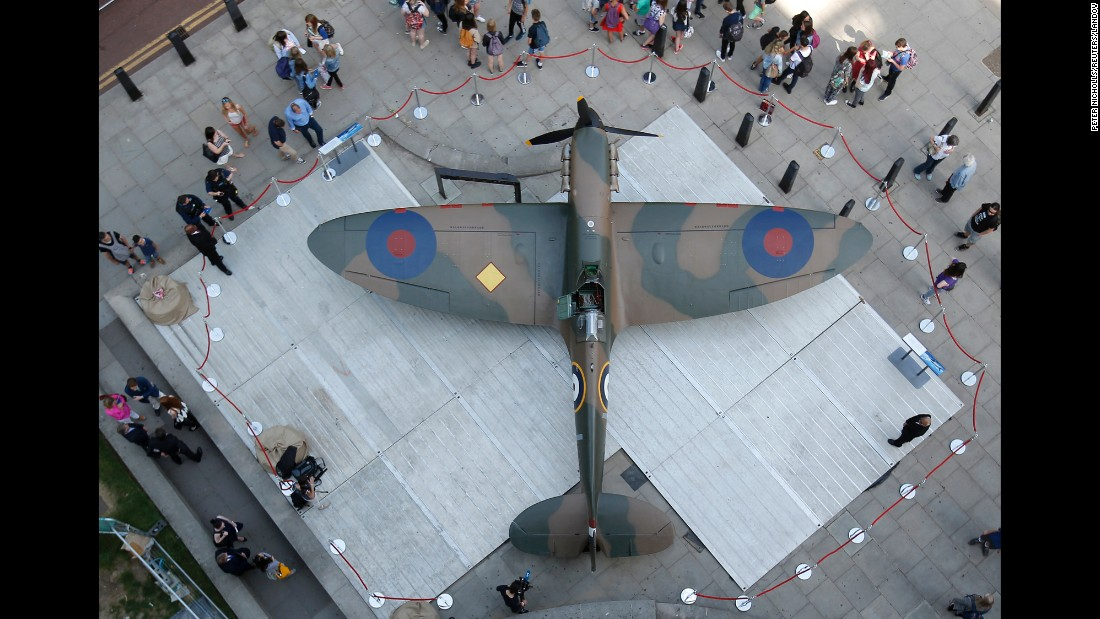 People look at an Mk.1 Spitfire outside the Churchill War Rooms in London on Friday, July 3. The aircraft was expected to sell for millions at auction.