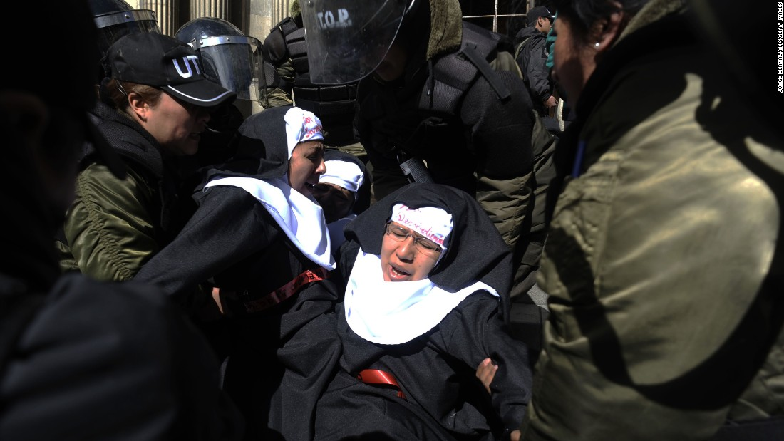 Activists dressed as nuns are taken away by police during a demonstration in La Paz, Bolivia, on Monday, July 6. The group was protesting the upcoming visit of Pope Francis.