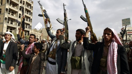Yemeni supporters of the Shiite Houthi movement raise their weapons during a rally in the capital Sanaa