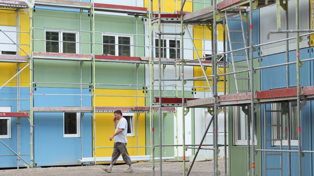 A worker walks through a container facility under construction in the Zehlendorf district that will house refugees and asylum applicants on July 9, 2015 in Berlin, Germany. This will be Berlin's sixth container accommodation as the city expands its capacity to house arriving refugees. Germany received the highest number of asylum seekers last year, with over 173,000 applications, according to a report by the United Nations.