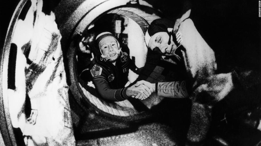 At left is Alexei Leonov, commander of the Soviet crew of Soyuz 19, shaking hands with Thomas Stafford, commander of the American crew of Apollo 18, on July 17, 1975. This would be the last Apollo mission conducted by NASA.