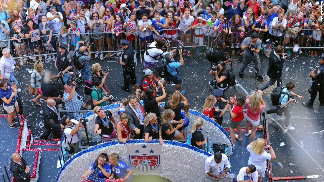 New York Gov. Andrew Cuomo, center, participates in the parade. The U.S. women's team defeated Japan 5-2 to take its third World Cup title.