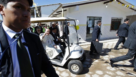 Pope Francis waves from a golf cart after visiting with prisoners in Santa Cruz, Bolivia, on July 10. The Pope wrapped up his trip to Bolivia with a visit to its notoriously violent and overcrowded Palmasola prison.