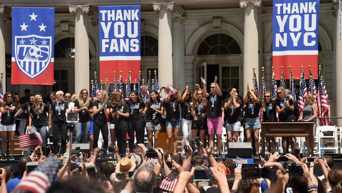Mayor Bill de Blasio salutes the U.S. women's soccer team at a City Hall ceremony Friday.