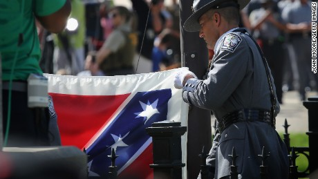 A South Carolina honor guard lowers the Confederate flag from the Statehouse grounds on July 10, 2015 in Columbia, South Carolina.