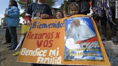 Faithful wait for Pope Francis on the way from the airport to Asuncion, Paraguay on July 10, 2015. The pope heads to Paraguay, the final destination of his week-long tour of South America, which started in Ecuador. AFP PHOTO / Juan MabromataJUAN MABROMATA/AFP/Getty Images