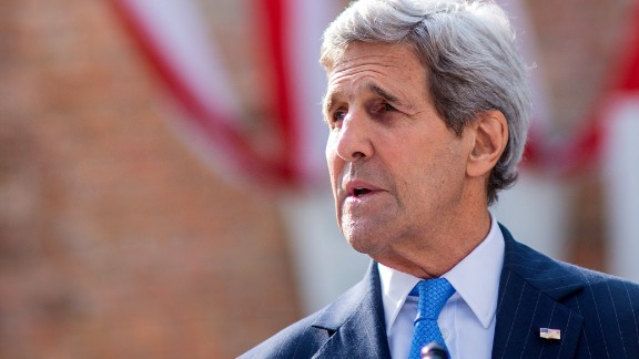 U.S. Secretary of State John Kerry walks delivers a statement on Cuba outside the hotel where the Iran nuclear talks meetings are being held in Vienna, Austria, July 1, 2015.