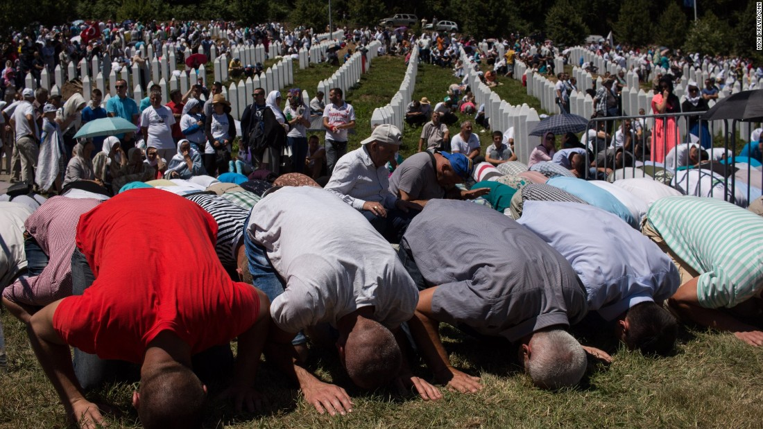 Thousands of mourners pray beside the graves of more than 6,000 people murdered in the Srebrenica genocide. Around 8,000 are believed to have been killed in total.