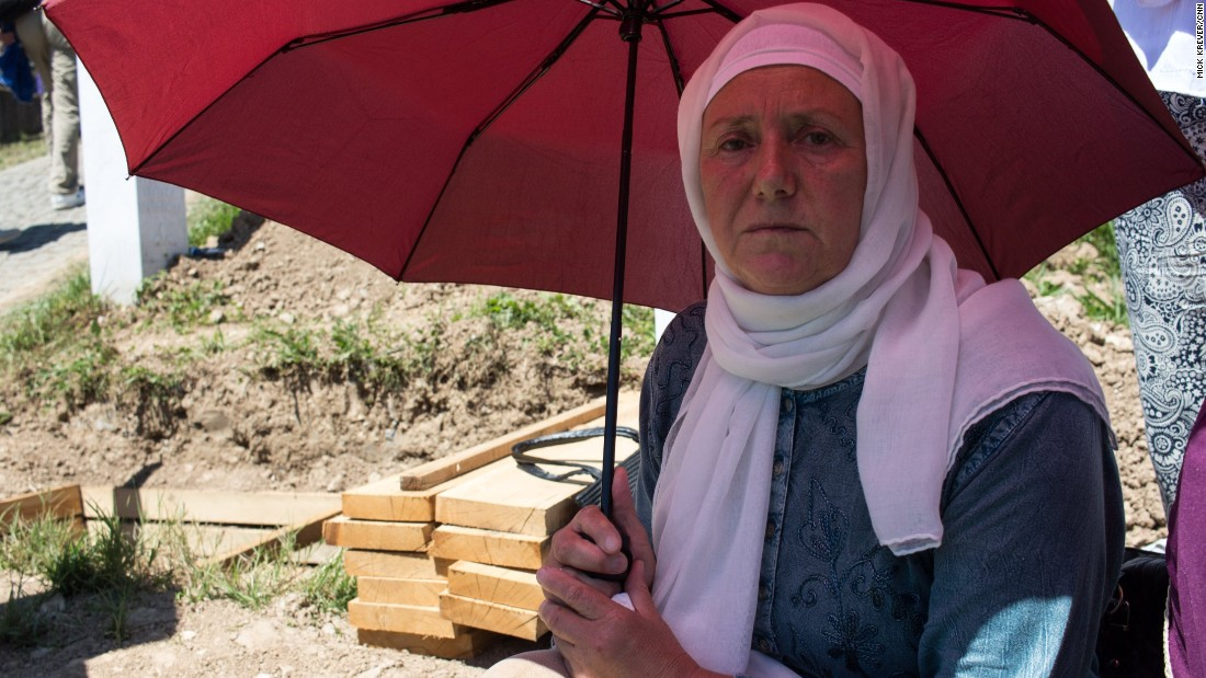 "Hadzira Dozic's brother was 32 when killed in 1995. She sits beside an open grave, waiting for his remains to finally be buried. Her husband and three of his brothers were also killed, along with around 30 other family members. ""It can never be done. How can it be done?"""