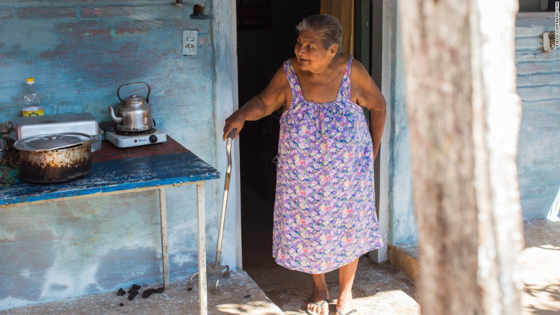 Asuncion Jimenez prepares lunch for family members outside her home. She is looking forward to meeting the Pope when he visits her family.  She hopes to sit next to him and make him lunch.