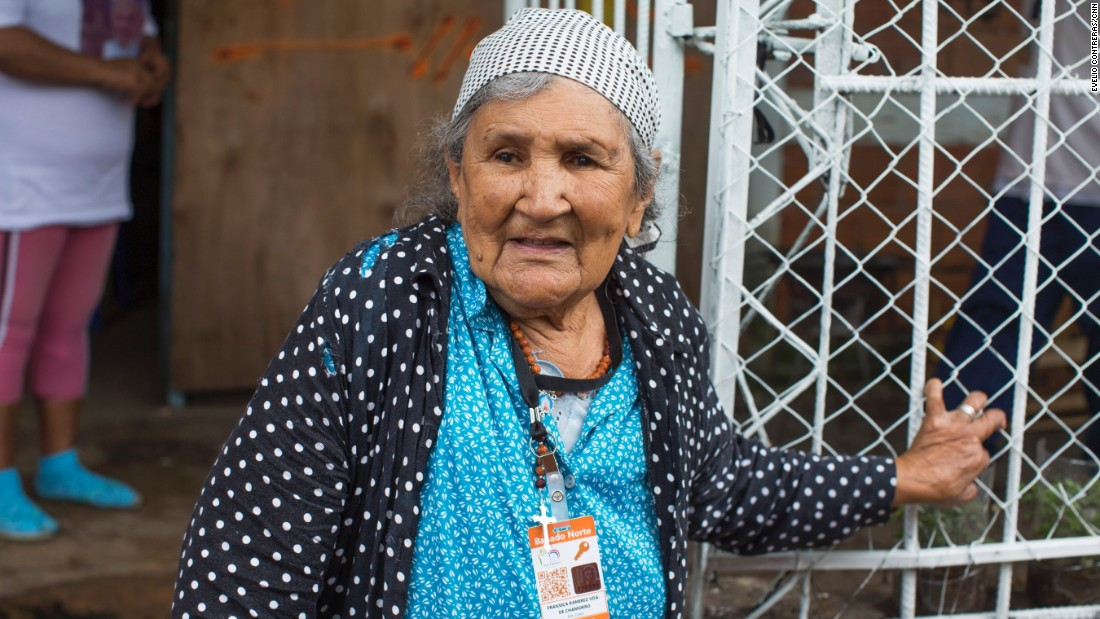 Francisca Ramirez plans to sing a song to Pope Francis when he arrives to visit her and her neighbors. Homes have been lathered with fresh paint.