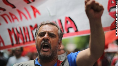 An anti-austerity demonstrator joins a rally in the streets of Athens on Saturday, July 11.