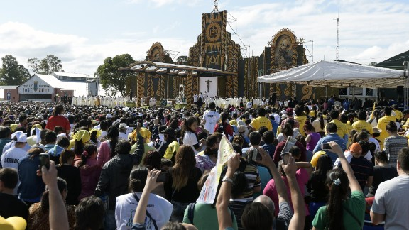 The faithful attend the Mass at Nu Guazu field in the outskirts of Asuncion on July 12.
