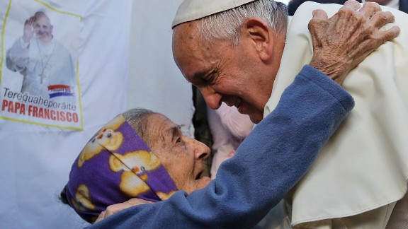An elderly woman greets the Pope during his visit to the Banado Norte neighborhood in Asuncion on July 12.