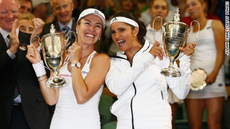 Martina Hingis and Sania Mirza celebrate winning the women's doubles final at Wimbledon on July 11, 2015.