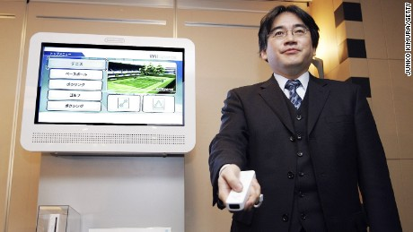Nintendo president Satoru Iwata presents the Wii game console during a press conference on December 7, 2006 in Tokyo, Japan.
