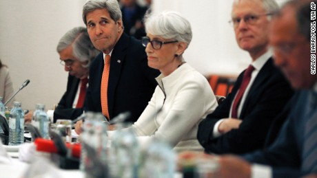 U.S. Secretary of State John Kerry, second from left, meets with foreign ministers and delegations from Germany, France, China, Britain, Russia and the European Union at a hotel in Vienna, Austria, Monday, July 13, 2015.