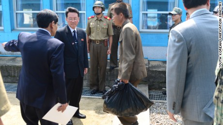 Two North Korean sailors were returned to North Korean authorities at the village of Panmunjom.