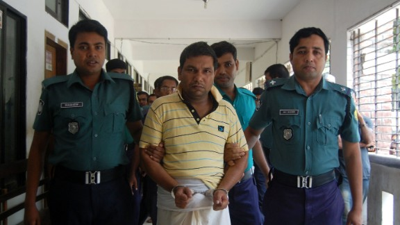 Bangladeshi police escort a suspect in the beating death of a 13-year-old boy in Sylhet.