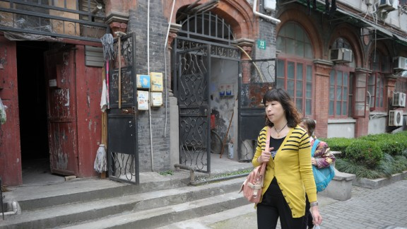 A woman walks through Shanghai's former Jewish ghetto on May 7, 2013. Today, there are few remnants of its Jewish history although organizations like the Shanghai Jewish Refugees Museum are trying to change this.