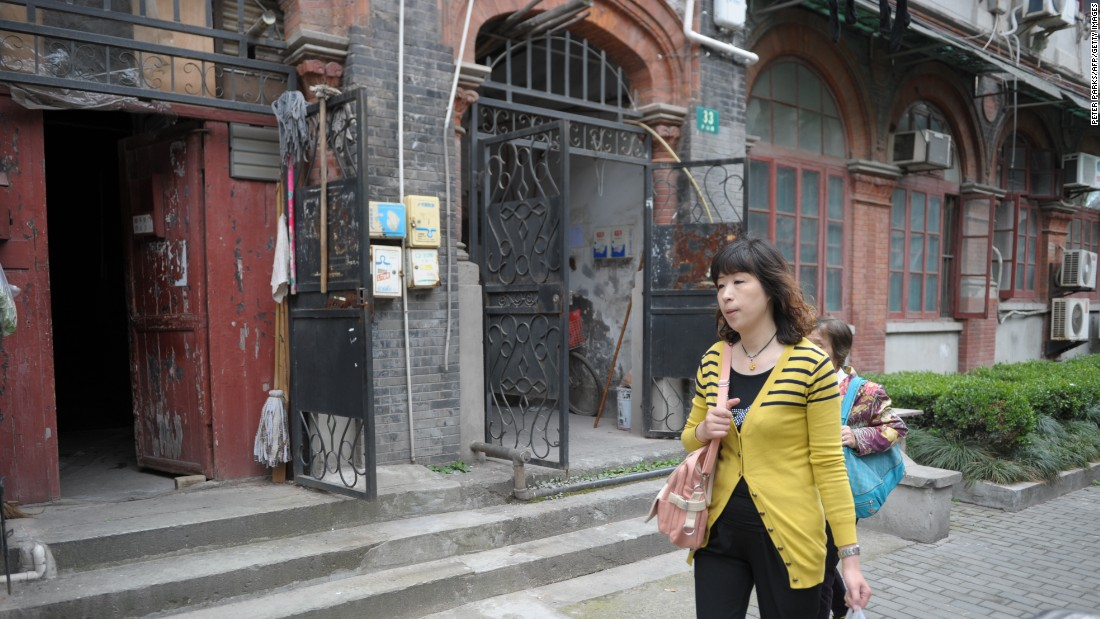 "A woman walks through Shanghai's former Jewish ghetto on May 7, 2013. Today, there are few remnants of its Jewish history although organizations like the <a href=""http://chrlawyers.hk/en/content/1100-14-july-2015-146-lawyers-law-firm-staffhuman-right-activists-have-been-detainedarrested"" target=""_blank"">Shanghai Jewish Refugees Museum</a> are trying to change this."
