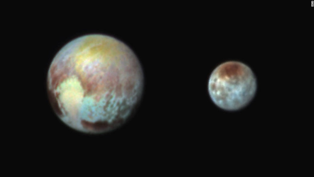 The colors in this image of Pluto and Charon are exaggerated to make it easy to see their different features. (These are not the actual colors of Pluto and Charon, and the two bodies aren't really that close together in space.) This image was created on July 13, one day before New Horizons was to make its closest approach to Pluto.