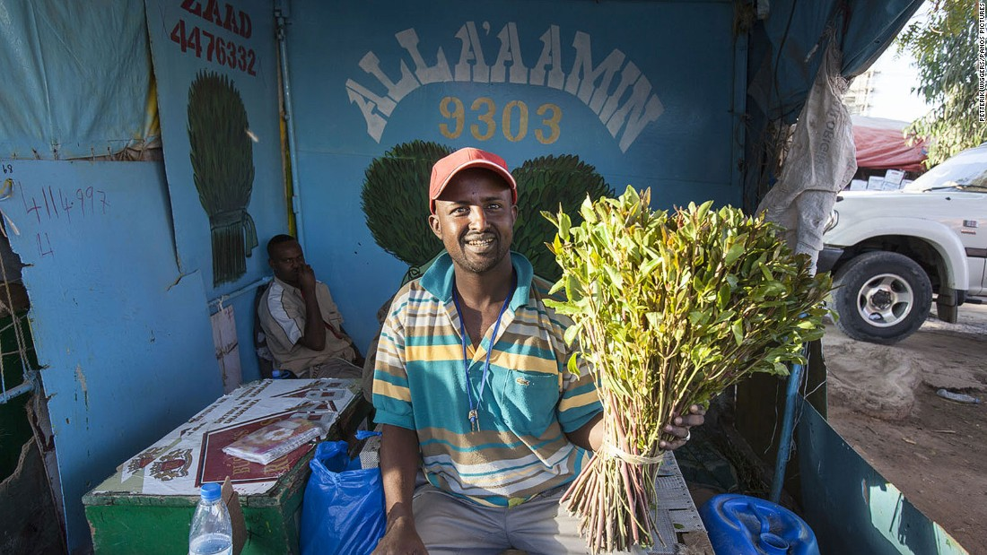 A man purchases a bundle of the narcotic plant khat, which is hugely popular in Hargeisa.
