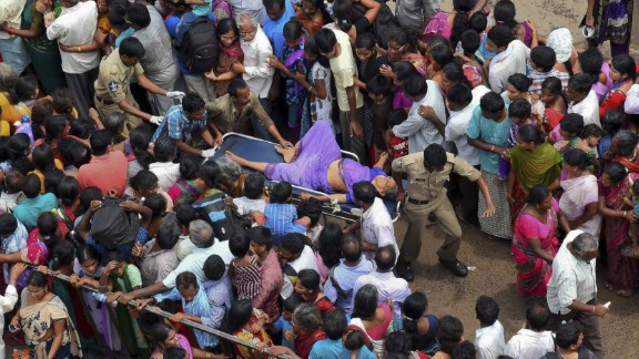 A woman is rushed to a hospital on a stretcher after the stampede.