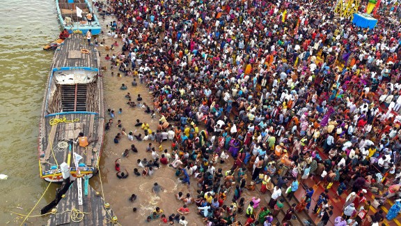 Thousands of people gather during a Hindu religious bathing festival on the bank of the Godavari River in the Andhra Pradesh state on July 14.