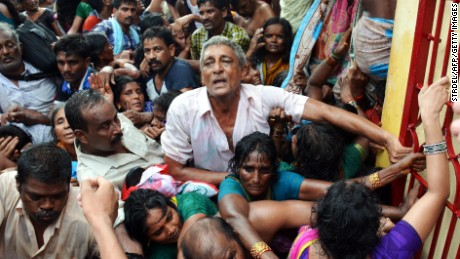 Indian devotees gather after a stampede at a religious festival in Godavari in the Rajahmundry district on July 14.
