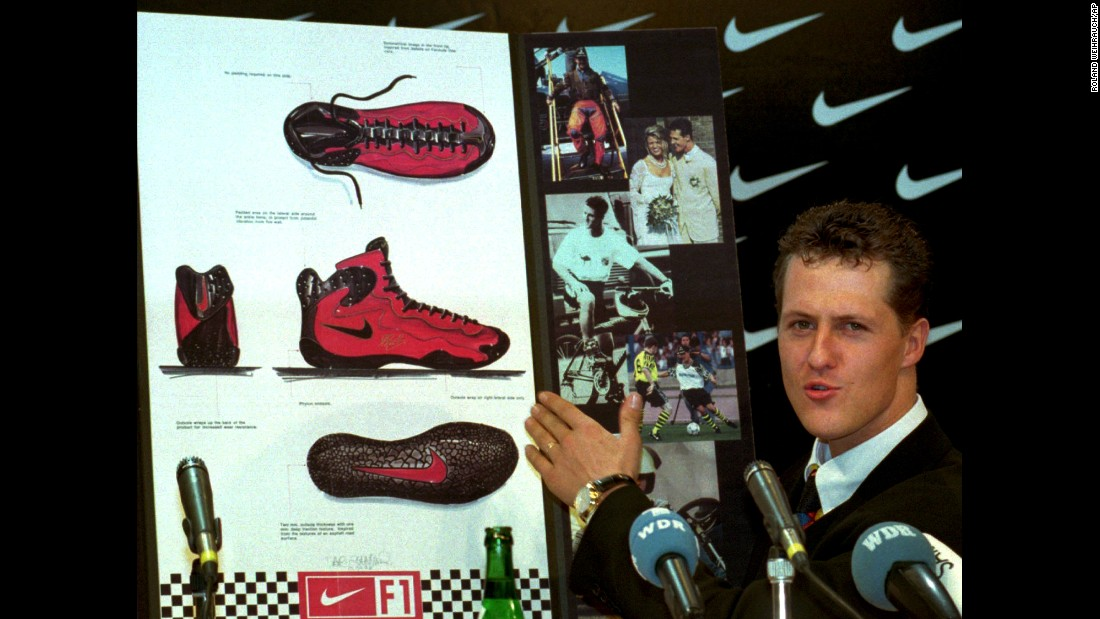 Formula One champion Michael Schumacher presents his new Nike racing shoe in Cologne, Germany, in January 1996. Throughout its history, Nike has signed endorsement deals with some of the biggest names in sports, including Schumacher, Tiger Woods, Roger Federer and LeBron James.