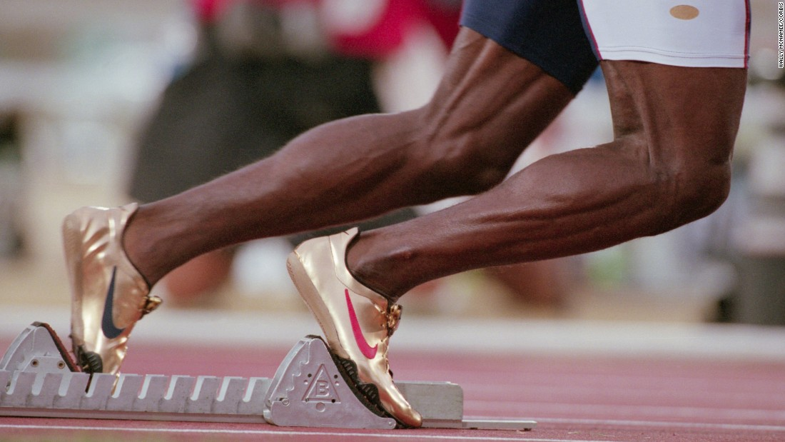 U.S. sprinter Michael Johnson wears gold Nike shoes at the 1996 Olympic Games in Atlanta. Johnson was one of the major stars of the Olympics, winning the 200 meters and the 400 meters in record time.