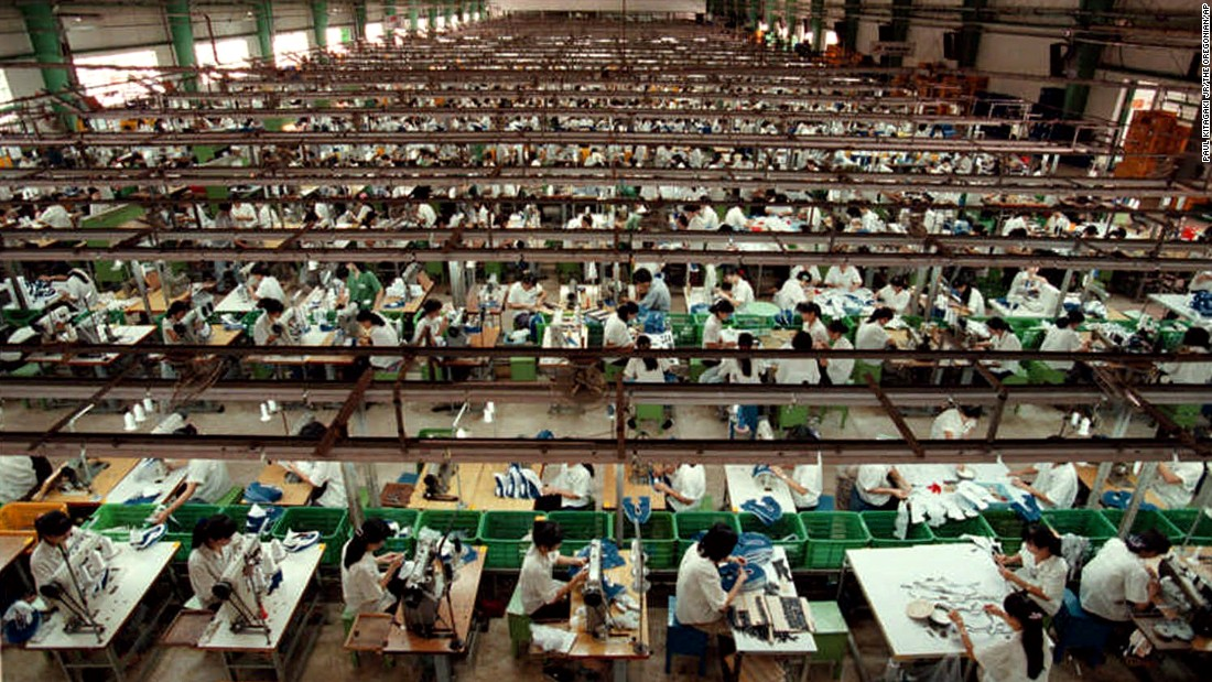 "Workers in Ho Chi Minh City, Vietnam, stitch Nike shoes in July 1997. In response to allegations of child labor in its overseas factories, Nike promised to improve working conditions and raise minimum ages. ""The Nike product has become synonymous with slave wages, forced overtime, and arbitrary abuse,"" <a href=""http://www.nytimes.com/1998/05/13/business/international-business-nike-pledges-to-end-child-labor-and-apply-us-rules-abroad.html"" target=""_blank"">Knight said when announcing the changes in May 1998.</a> ""I truly believe the American consumer doesn't want to buy products made under abusive conditions."""
