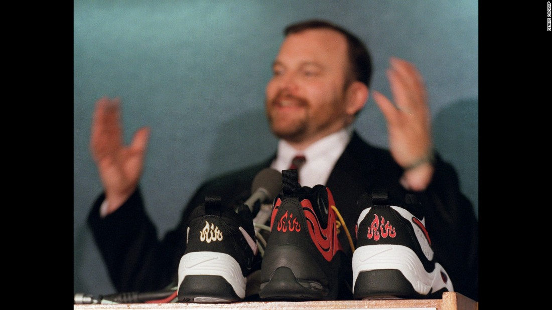 "Ibrahim Hooper, communications director of the Council on American-Islamic Relations, gestures during a June 1997 news conference with samples of Nike shoes in the foreground. Hooper's group said the ""Air"" symbol resembled ""Allah"" in Arabic, and the shoes were recalled. Nike apologized to Muslims for any unintentional offense."