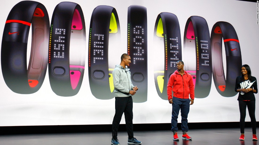 Olympic decathlete Ashton Eaton, left, and pro football player Victor Cruz speak at a Nike event in New York in October 2013. Nike was introducing its FuelBand activity tracker, continuing to expand its business past more than shoes. The company also makes equipment for just about every sport.