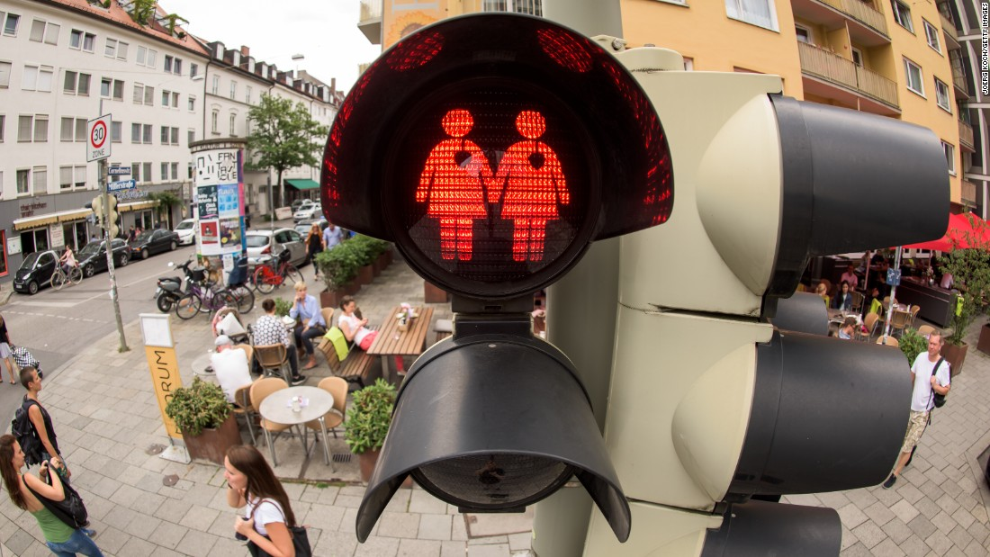 A pedestrian crossing signal shows a lesbian couple at a junction in Munich, Germany on July 14, 2015. The city, taking a cue from a similar project in Vienna, introduced the new signals at a limited number of traffic lights downtown for the recent LBGT pride festival, also known as Christopher Street Day, named after the location of the Stonewall Inn in New York, and has since decided to keep them.