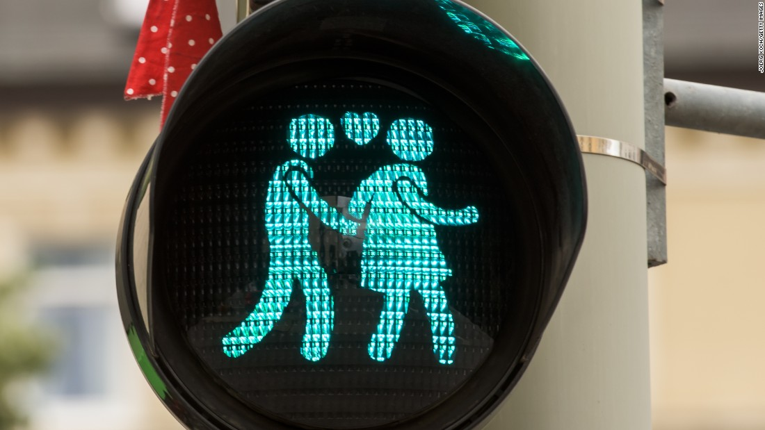 Straight people aren't left out of the street love. A pedestrian crossing signal shows a heterosexual couple at a junction in Munich on July 14.
