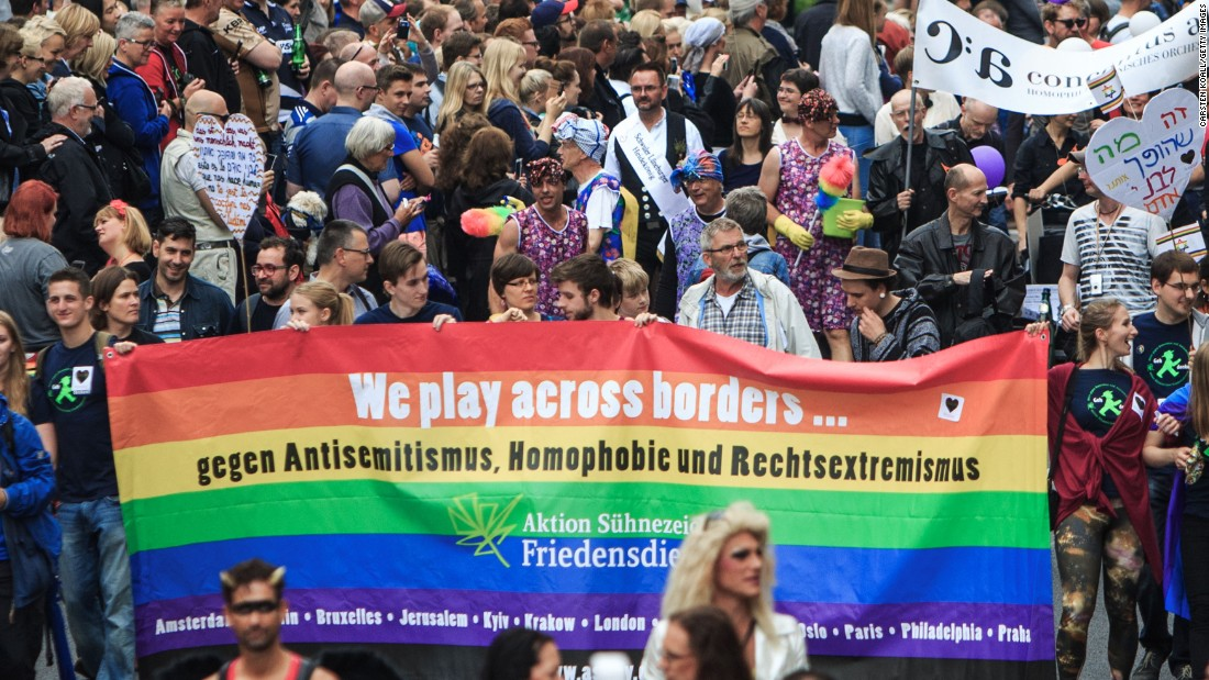 Participants show a banner with rainbow colors as they attend the Christopher Street Day parade in Berlin, Germany on June 27.