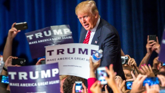 Republican Presidential candidate Donald Trump addresses supporters during a political rally at the Phoenix Convention Center on July 11, 2015 in Phoenix, Arizona.