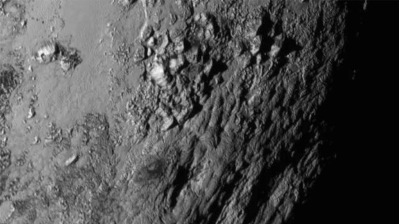 Close-up images of a region near Pluto's equator revealed a giant surprise: a range of youthful mountains. NASA released the image on July 15.