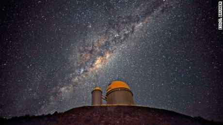 The Milky Way Galaxy stretches over the European Southern Observatory's 3.6-meter telescope in La Silla, Chile.