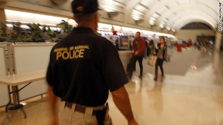 A federal air marshal walks through a check-in area as travelers prepare to board flights at John Wayne Orange County Airport in Santa Ana, Calif., on the 10th anniversary of terrorist attacks on the U.S., Sunday, Sept. 11, 2011. (AP Photo/Reed Saxon/AP)