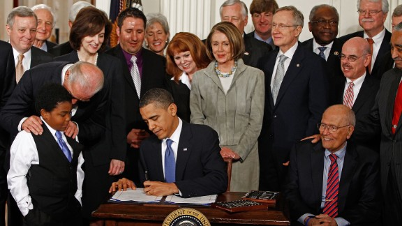 President Obama  signs the Affordable Health Care for America Act during a ceremony with fellow Democrats in the White House on March 23, 2010.