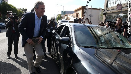 Republican presidential candidate and former Florida governor Jeb Bush gets out of an Uber car as he arrives at Thumbtack on July 16, 2015 in San Francisco, California.