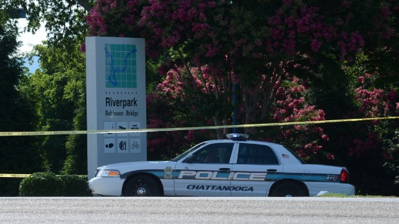 A police car blocks the entrances to the U.S. Navy Reserve Center on July 16.