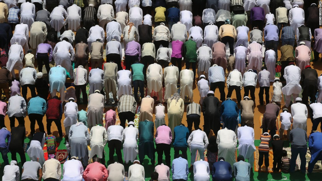 Muslims pray ahead of Eid ul-Fitr celebrations at Mecca Masjid in Hyderabad, India, on Friday, July 17. For the world's Muslims, the festival of Eid is a perfect conclusion to Ramadan -- the monthlong period of fasting and contemplation practiced by observers of Islam around the globe. One of the most festive periods in the religion's calendar, Eid is often commemorated with large feasts and family-time, and through charitable acts and donations.